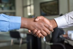 Two businessmen shaking hands to finalize agreement