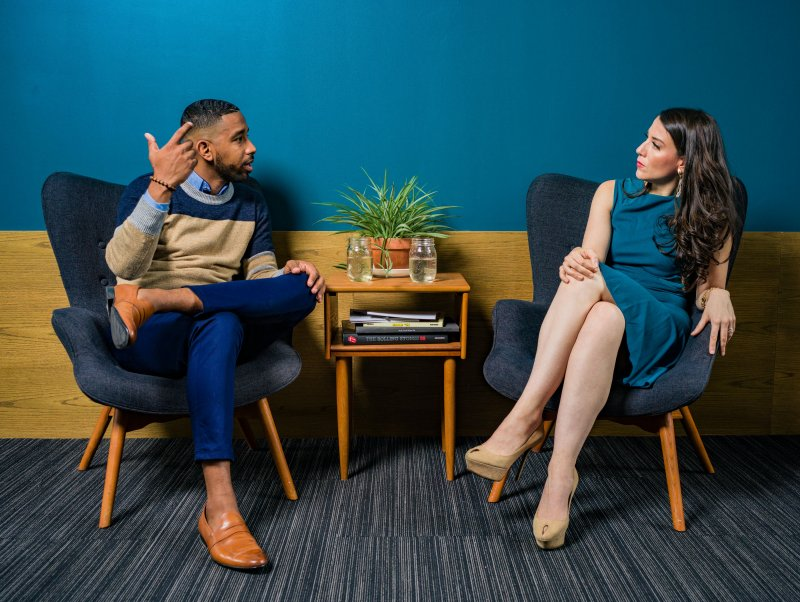 two people conversing, applying language learning tips